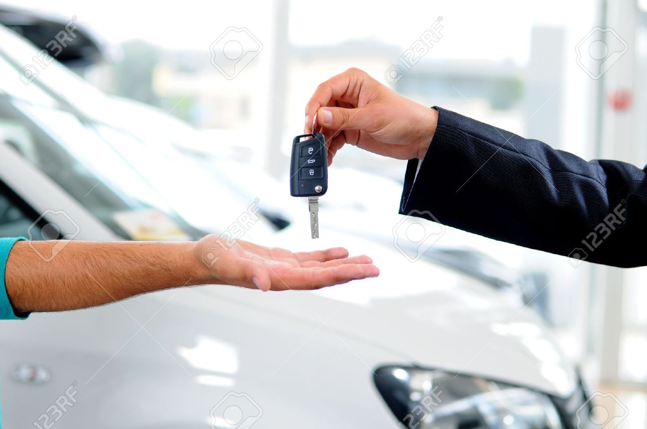 Key Car Dealership >> Handover Of Car Keys In A Dealership Stock Photo Picture And
