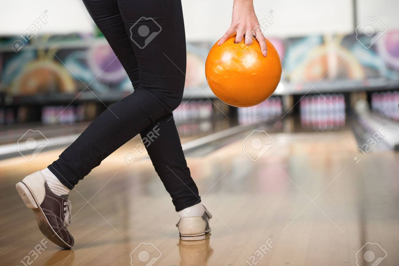 2787da01c49452 Young Woman Is Playing Bowling, Preparing To Throw Ball. Stock Photo ...