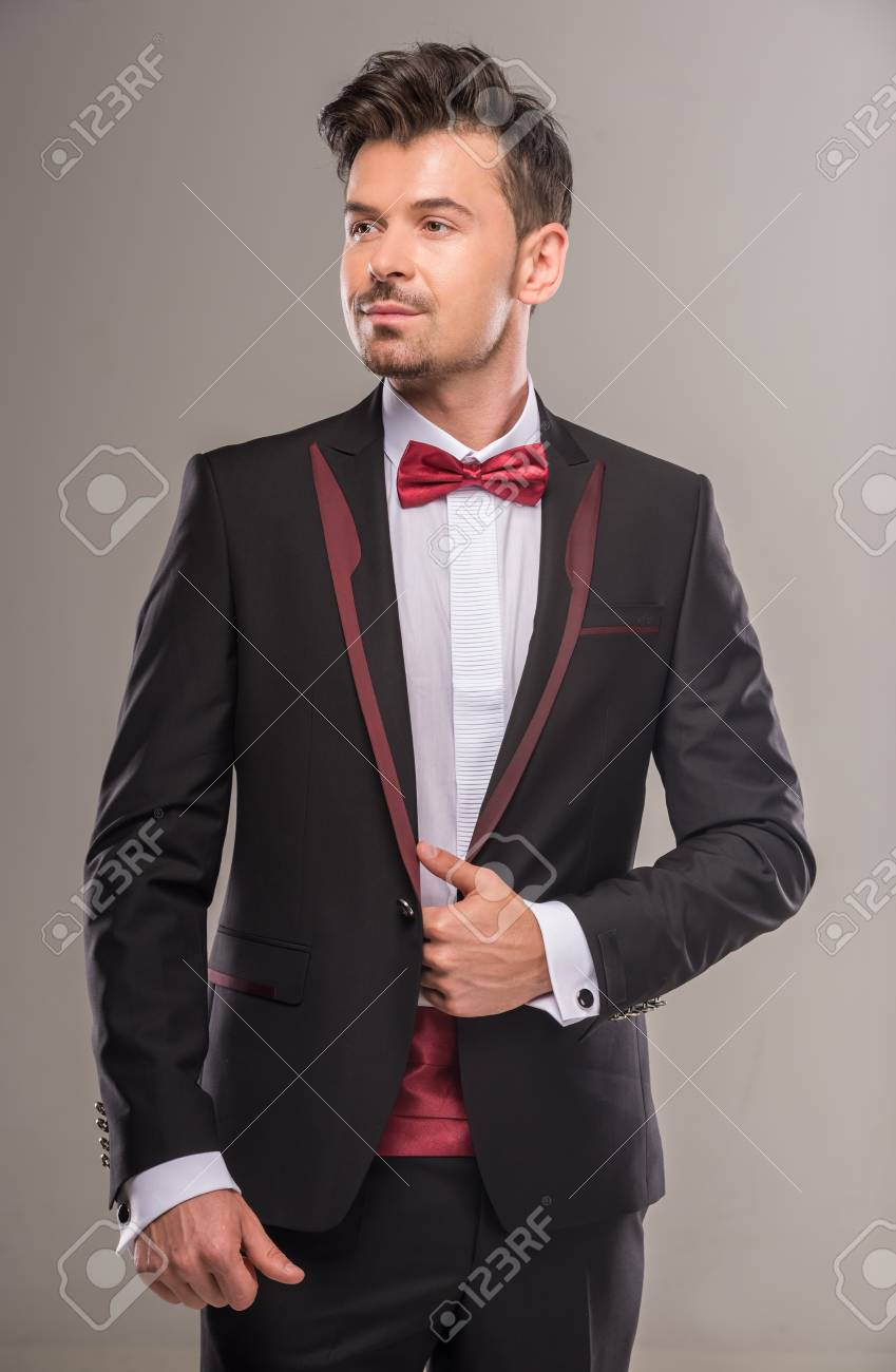 d491b5db19efa Portrait Of A Young Man In Black Suit And Red Bow-tie. Stock Photo ...