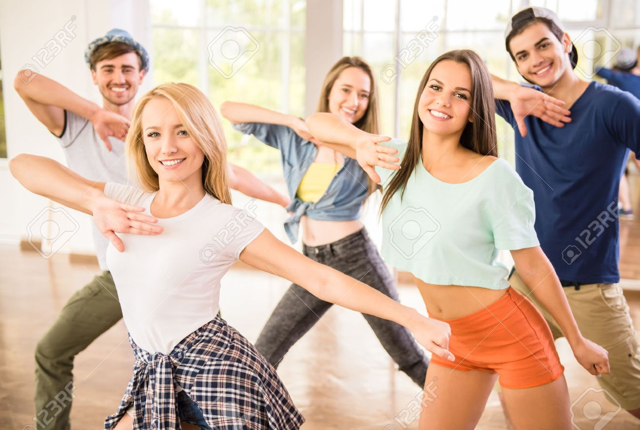 Young dancing people in gym during exercise dancer workout training with happy fresh energy. - 45748344
