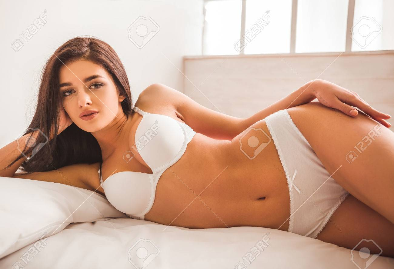 Young girl posing on bed