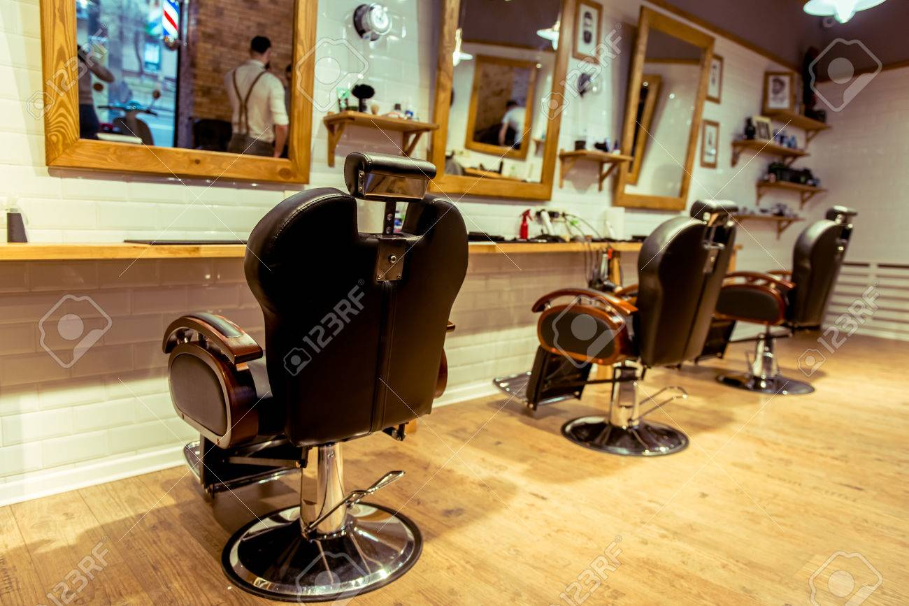 Stylish barber shop. Designed with white brick and wood. Take care of your hairstyle here! - 52671353