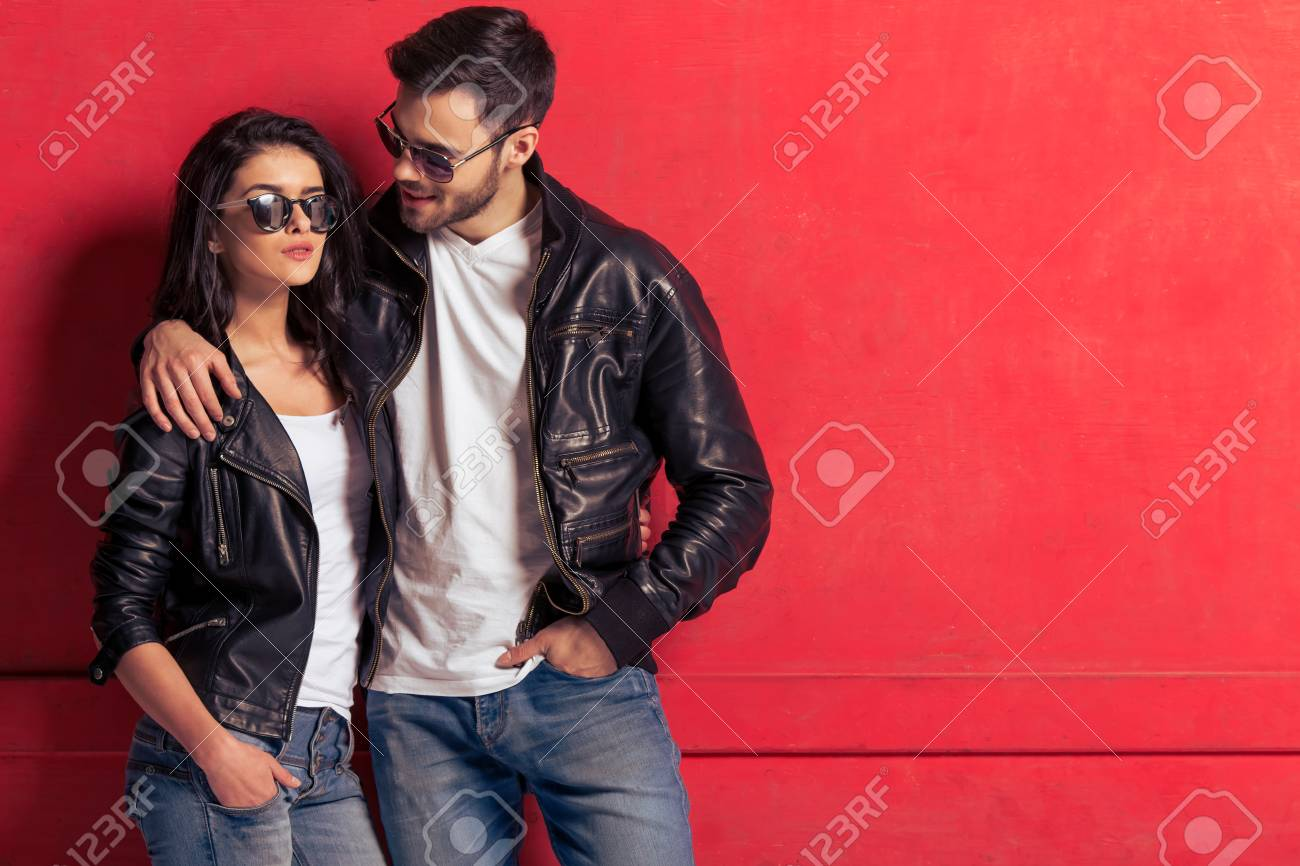 b13bb3bec Cool beautiful young couple in leather jackets and sunglasses..