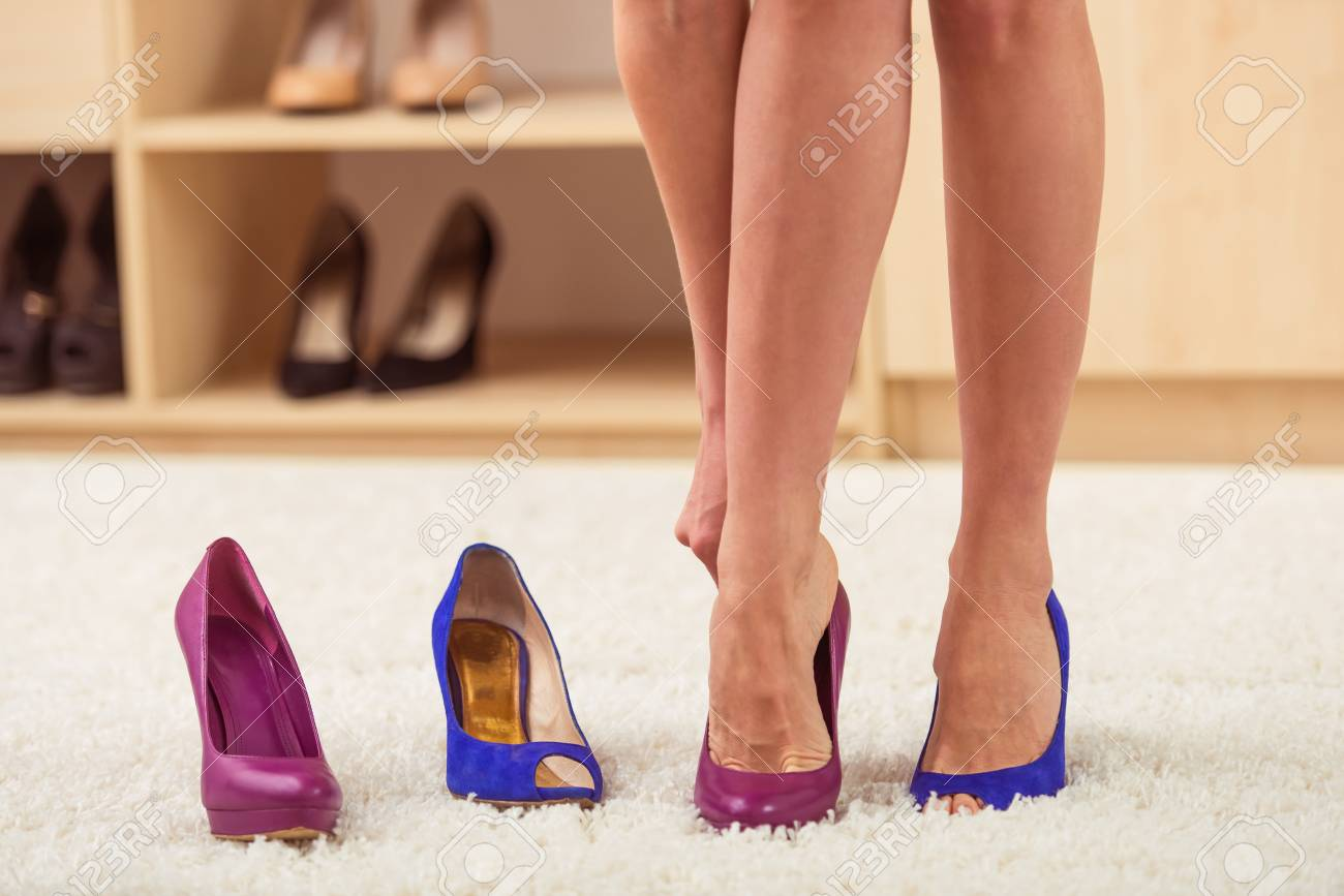 Beautiful Girl In Cocktail Dress Is Trying On High Heel Shoes ...