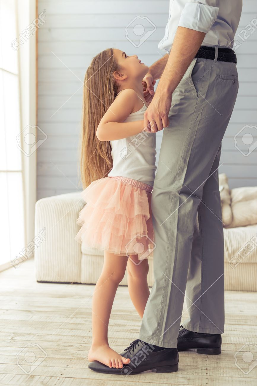 Cropped Image Of Young Father And His Cute Little Daughter Dancing