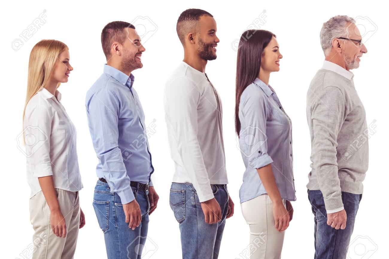 Side View Of Beautiful Business People In Smart Casual Wear Looking