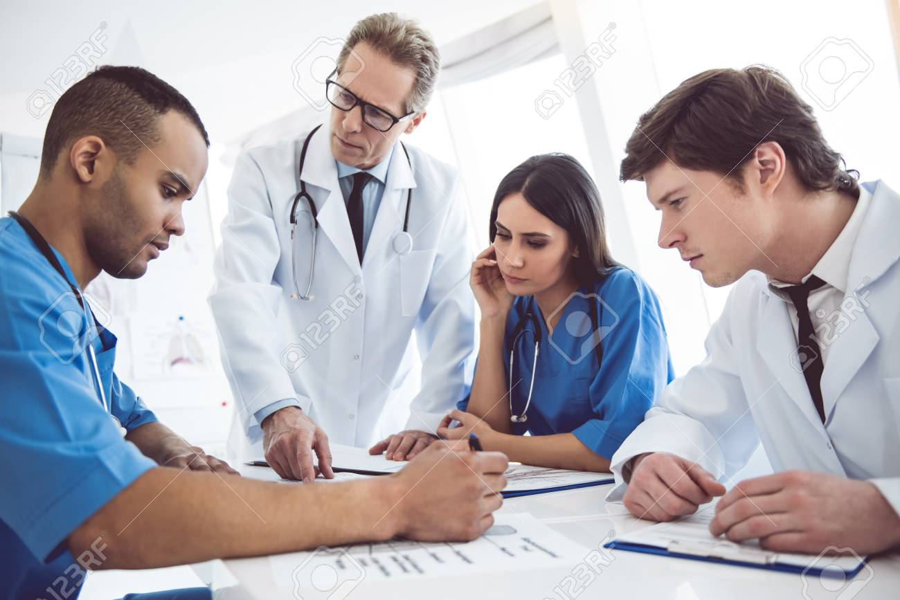 Successful medical doctors are discussing diagnosis during the conference - 72130031