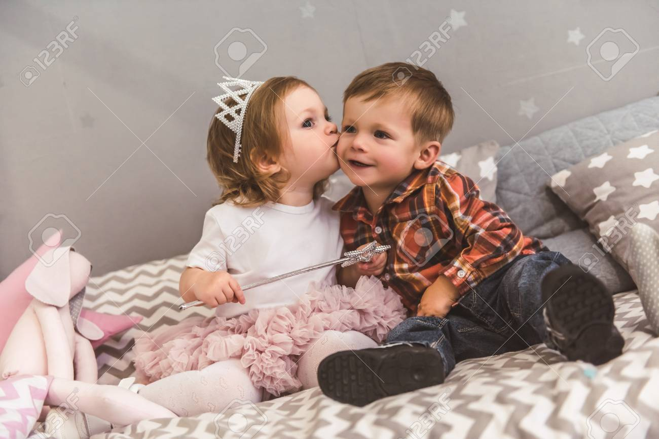 Cute Kids Are Playing Together In The Children S Room Boy Is