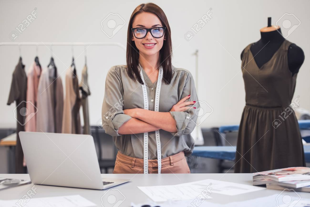 Attractive Fashion Designer Is Looking At Camera And Smiling Stock Photo Picture And Royalty Free Image Image 98091523