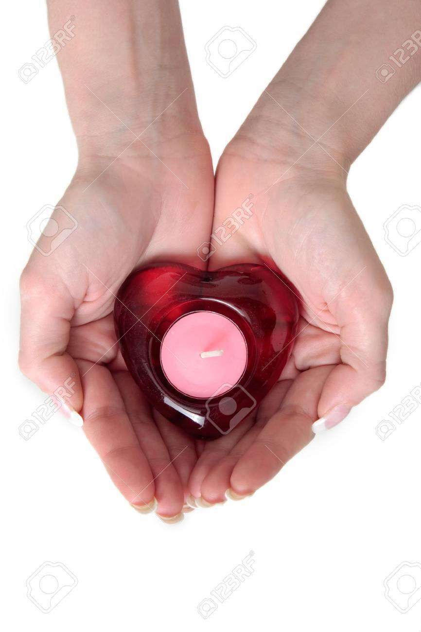 womans hands holding a heart candle in her hands Stock Photo - 305098