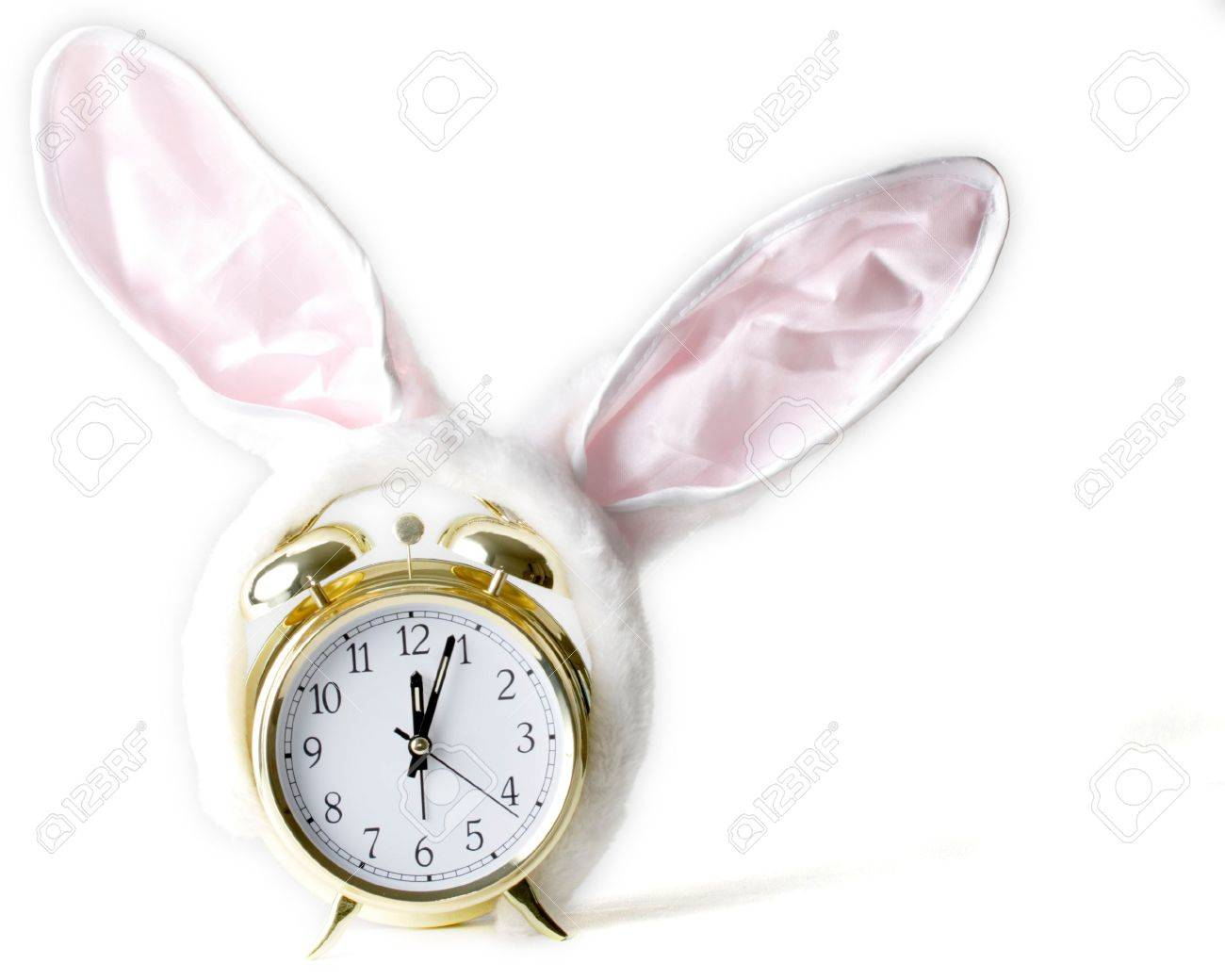 Gold alarm clock with bunny ears on showing Easter time Stock Photo - 328212