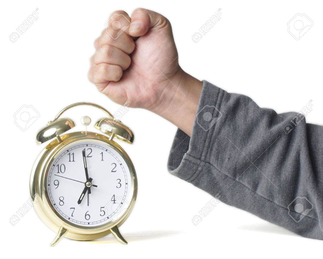 Man's hand in a fist about to hit a gold alarm clock Stock Photo - 328213
