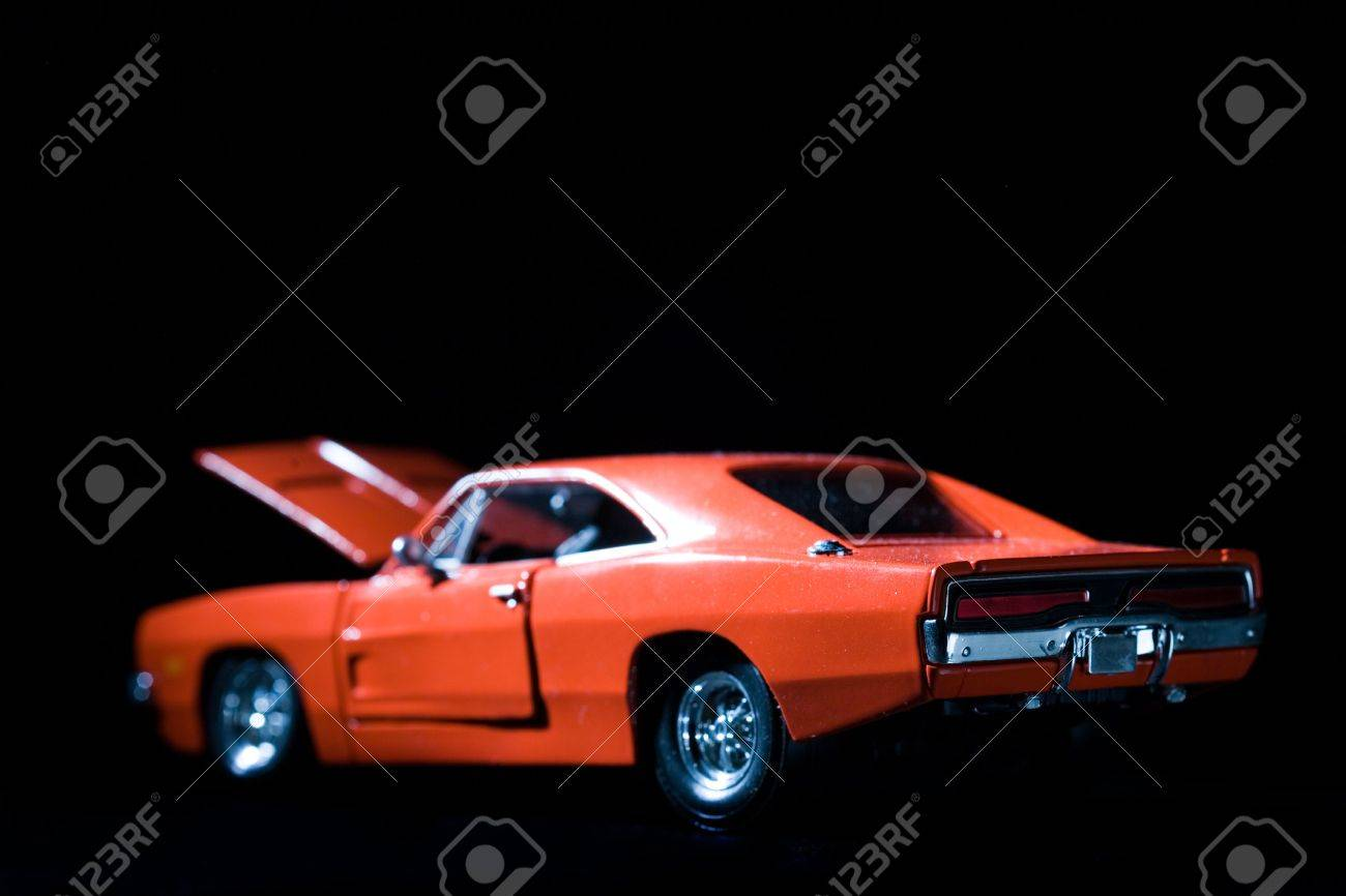 Old Retro Charger Muscle Car On Black With Hood Open Stock Photo