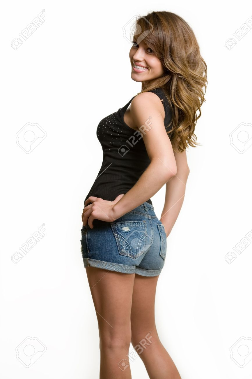 7863fe2cda0 beautiful brown hair woman wearing sexy denim shorts and tank top posing on  white background Stock