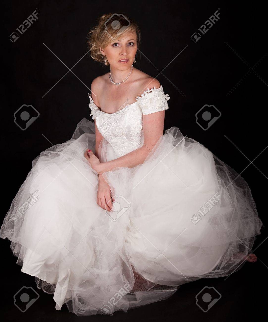 Attractive Blond Woman Wearing White Wedding Gown With Wide ...