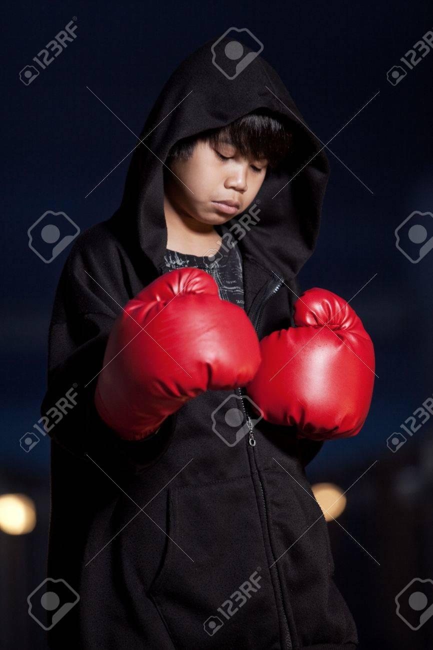 Asian boy boxing