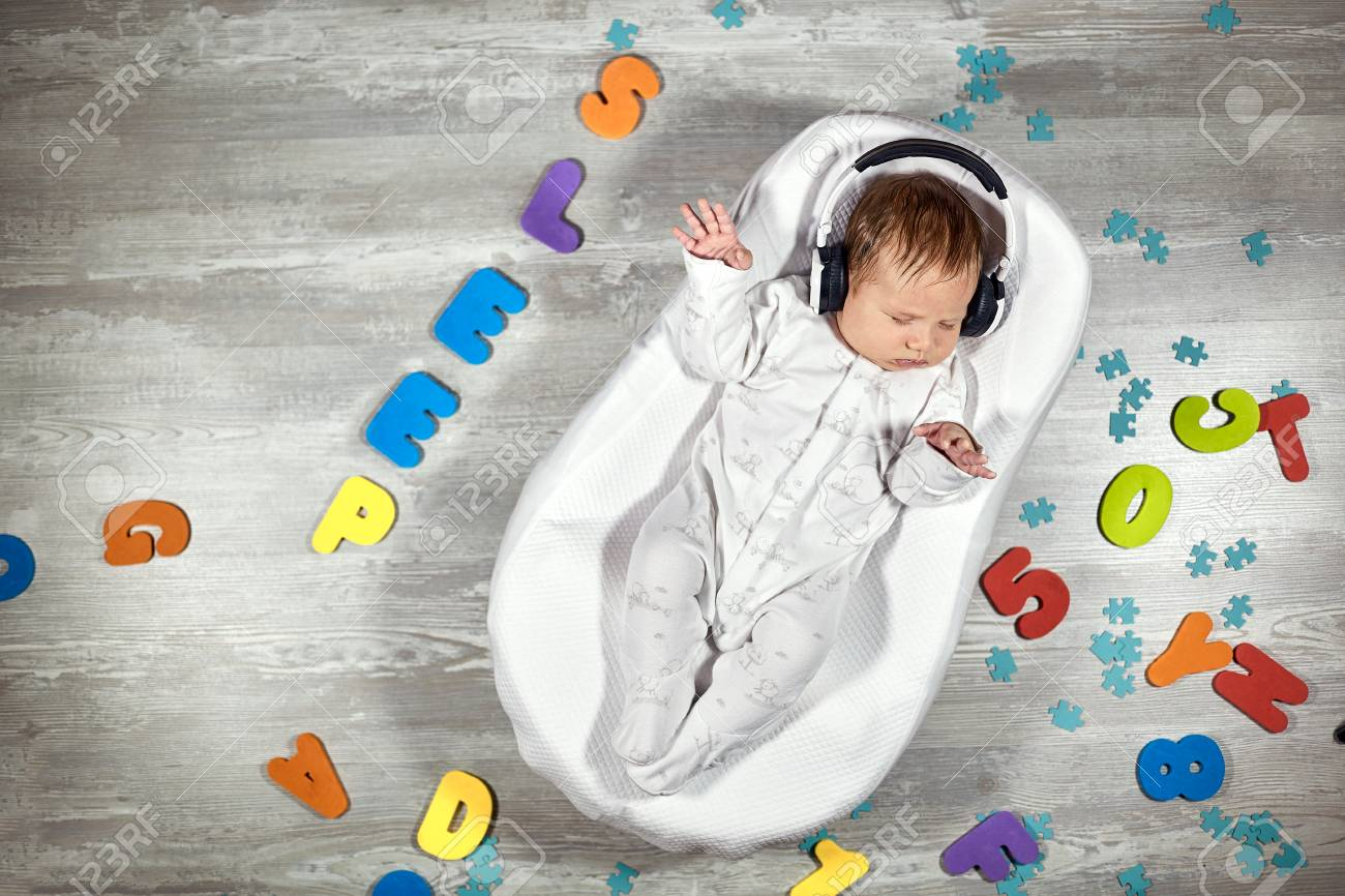 Newborn Baby In Headphones Sleeps In A Special Mattress Baby Stock Photo Picture And Royalty Free Image Image 117761036