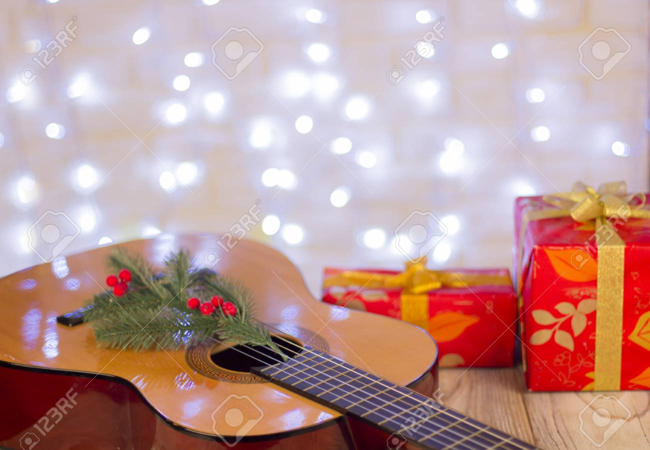 Christmas Music Background.Christmas Music Background For Text Guitar And Red Gifts