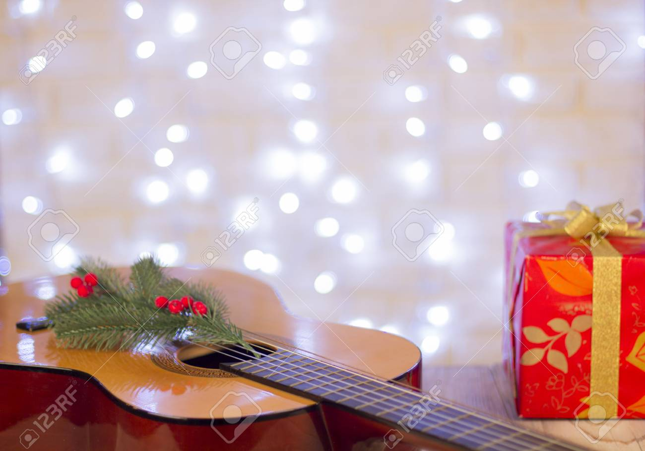 Christmas Music Background.Christmas Music Background With Guitar And Red Gift