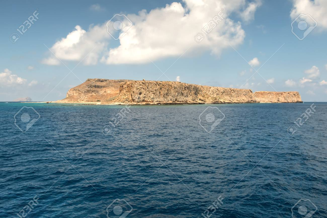 Mediterranean islands in the background of a blue sky - 115633129