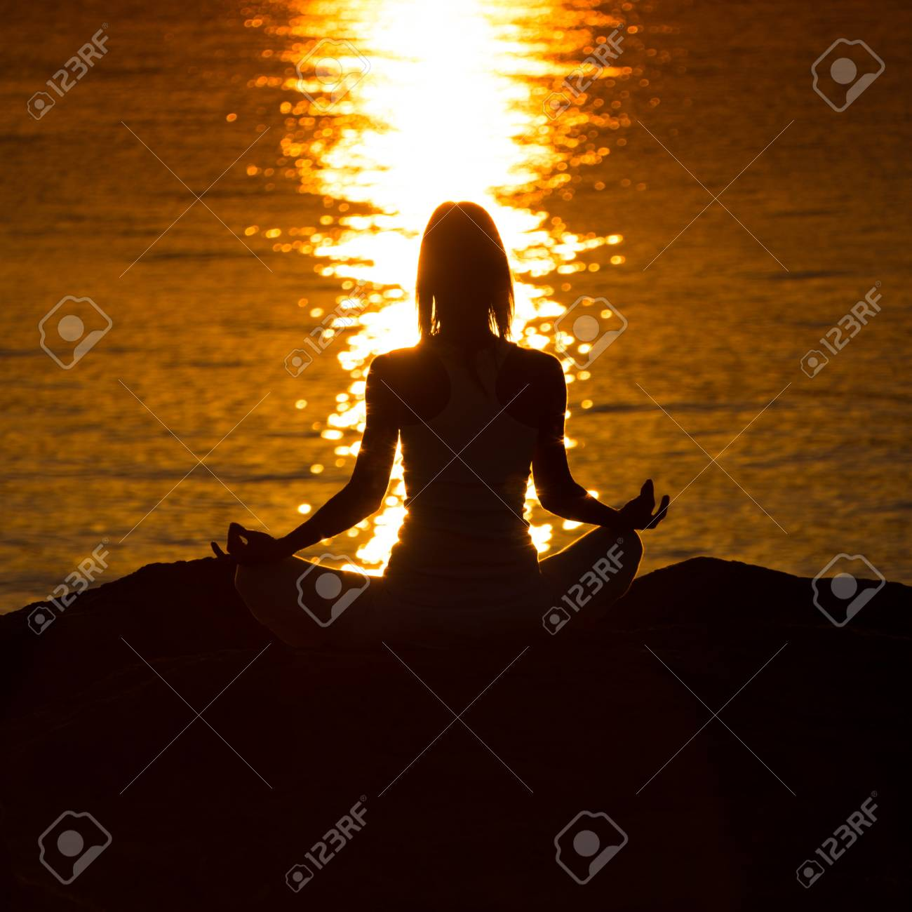 Silhouette of a woman doing yoga on the beach at sunset Stock Photo - 22101967