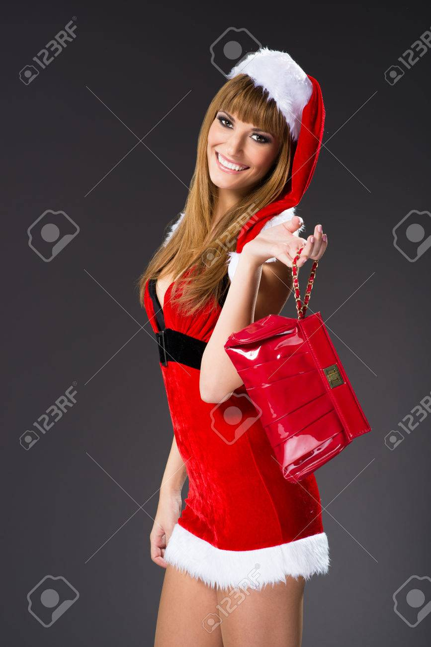 Portrait of beautiful girl wearing santa claus clothes - 22477013