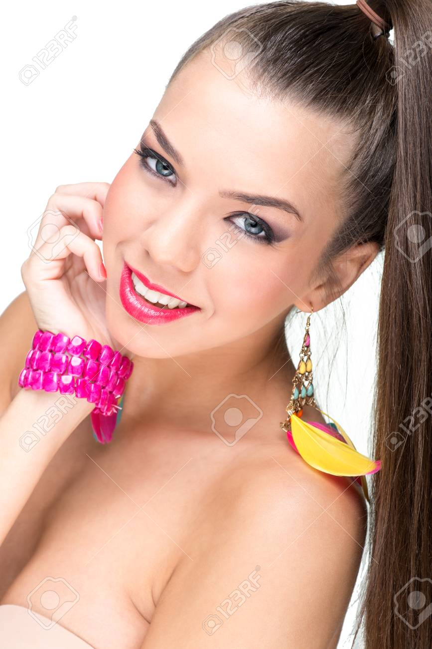 Beautiful-faced woman with feather earrings Stock Photo - 24260775