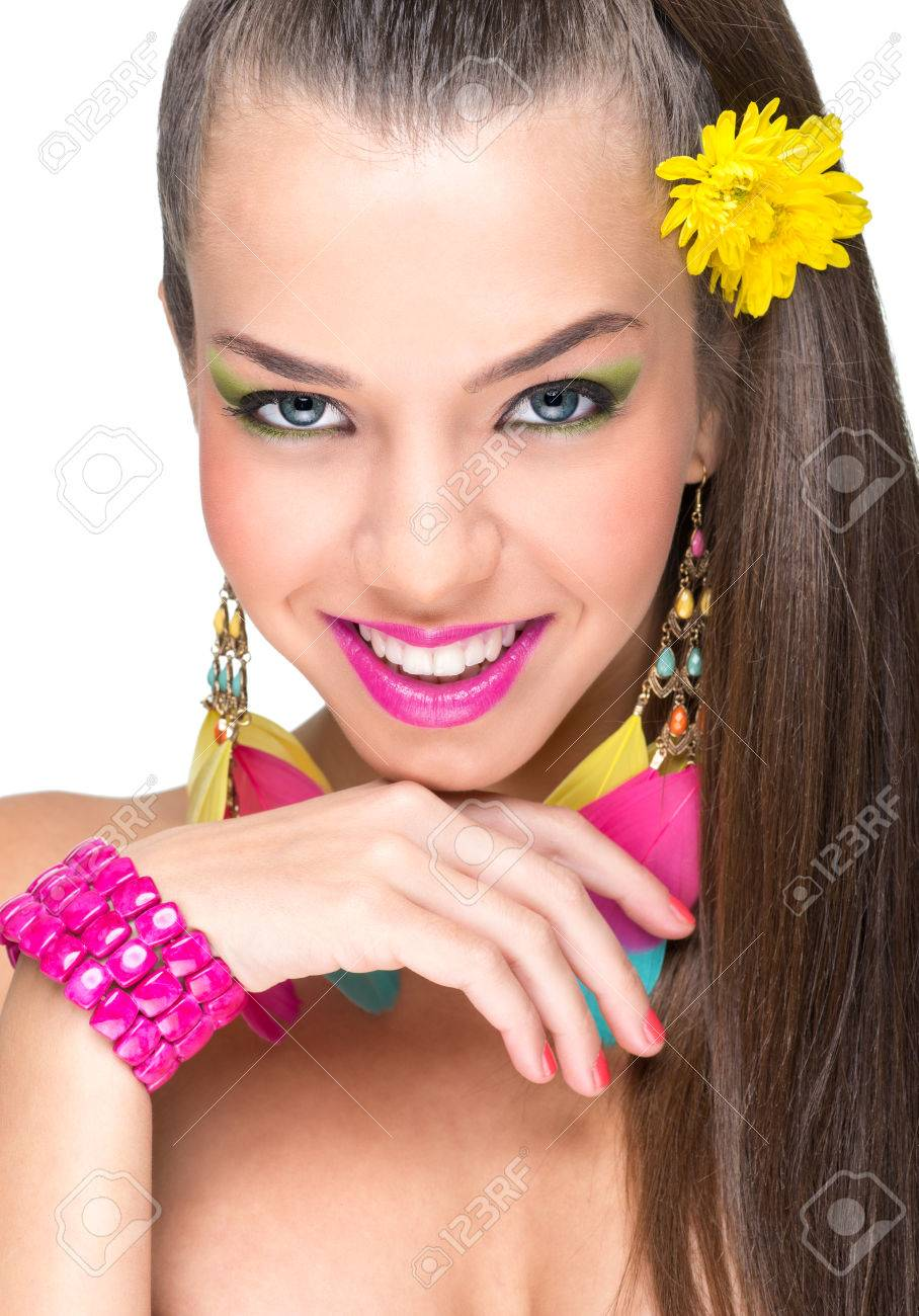 Beautiful-faced woman with feather earrings Stock Photo - 24260776
