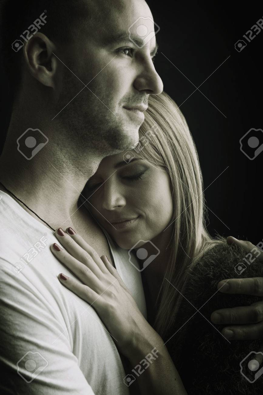 Lovers hug safety black and white photo stock photo 32439214