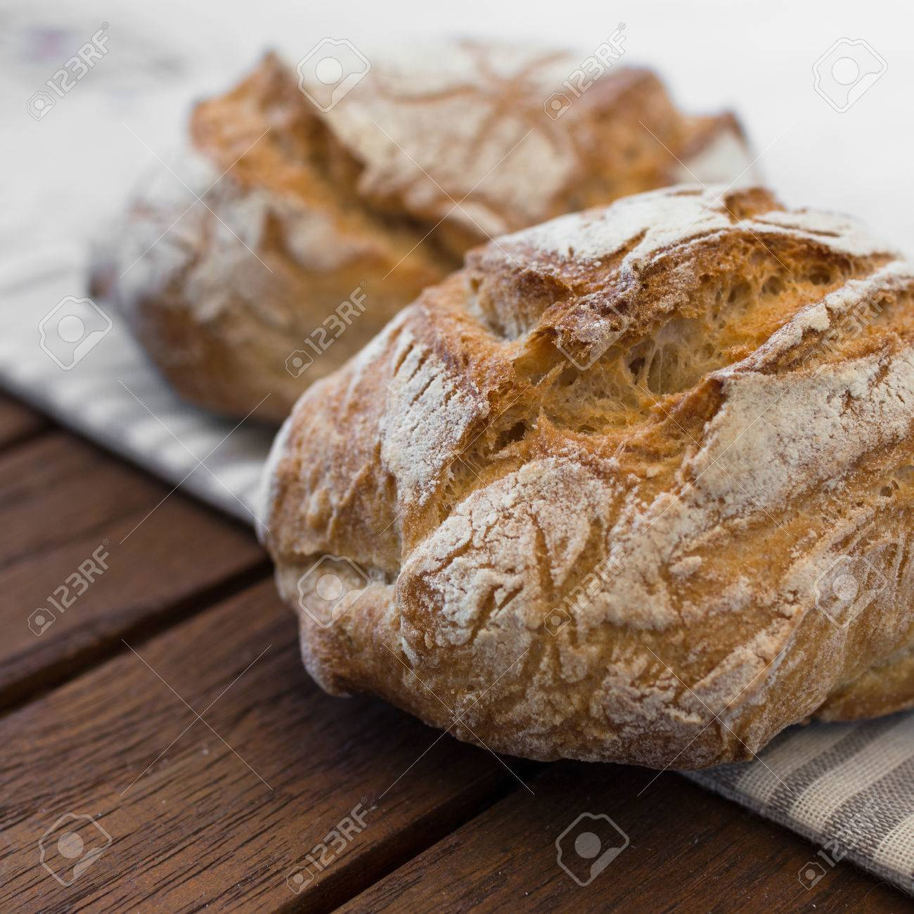 Extreme Clos Up Of Rustic Italian Bread Isolated On Background Out Focus