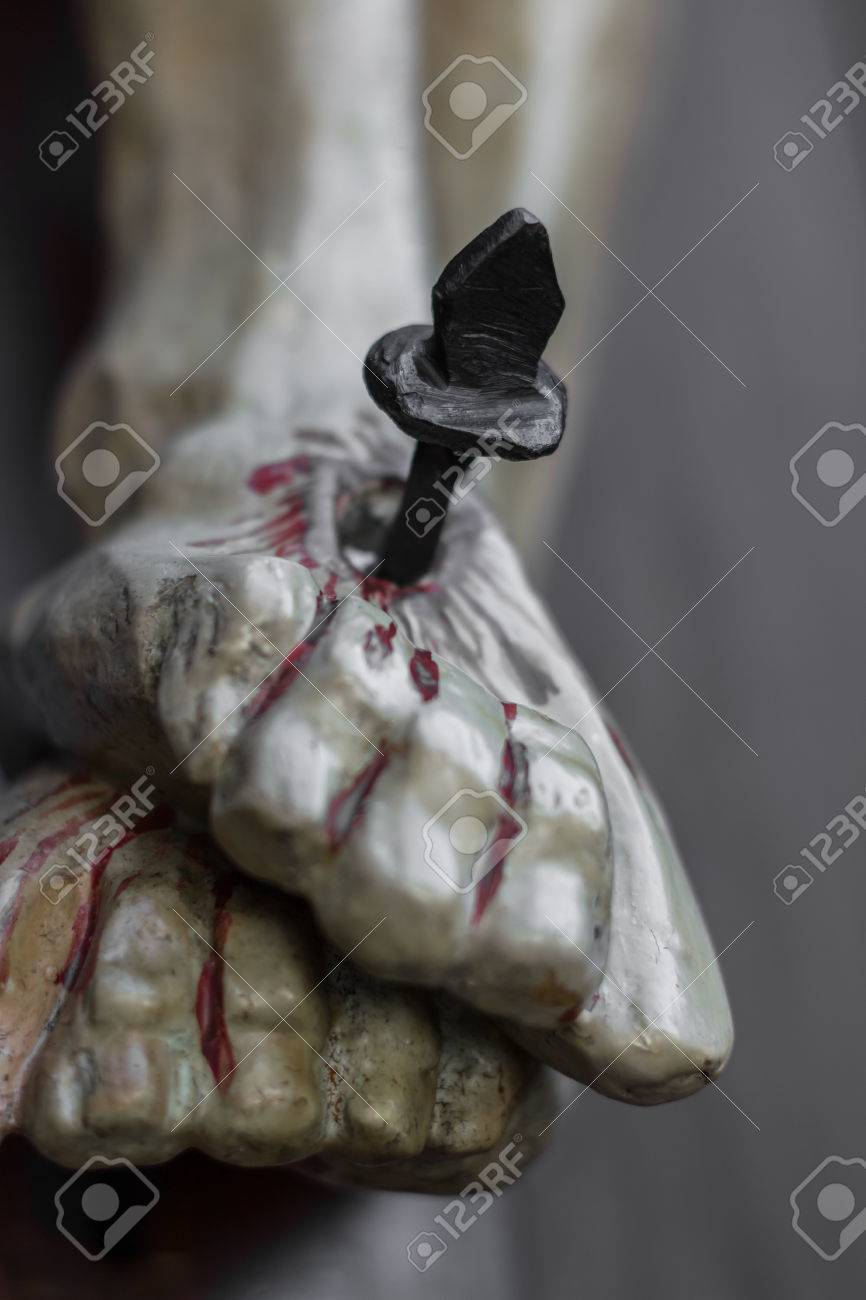 Closeup Of Feet Of Jesus Christ Nailed To The Cross During The ...