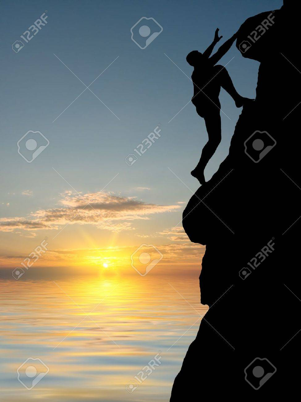 man on top of the mountain reaches for the sun Stock Photo - 10323720