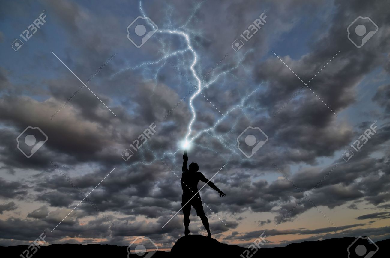 silhouette of a man on the hill out of the hand produces lightning. natural composition - 11260593