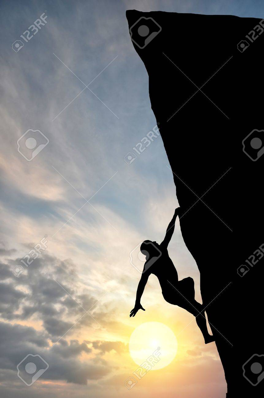 man on top of the mountain reaches for the sun - 11745776