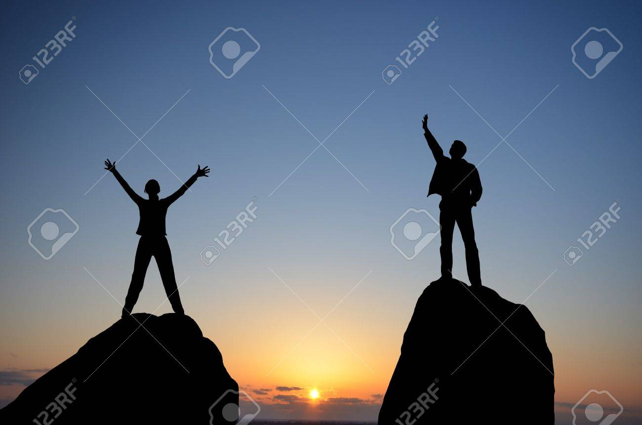 man and woman on top of a mountain on the background of the sunset - 12656108