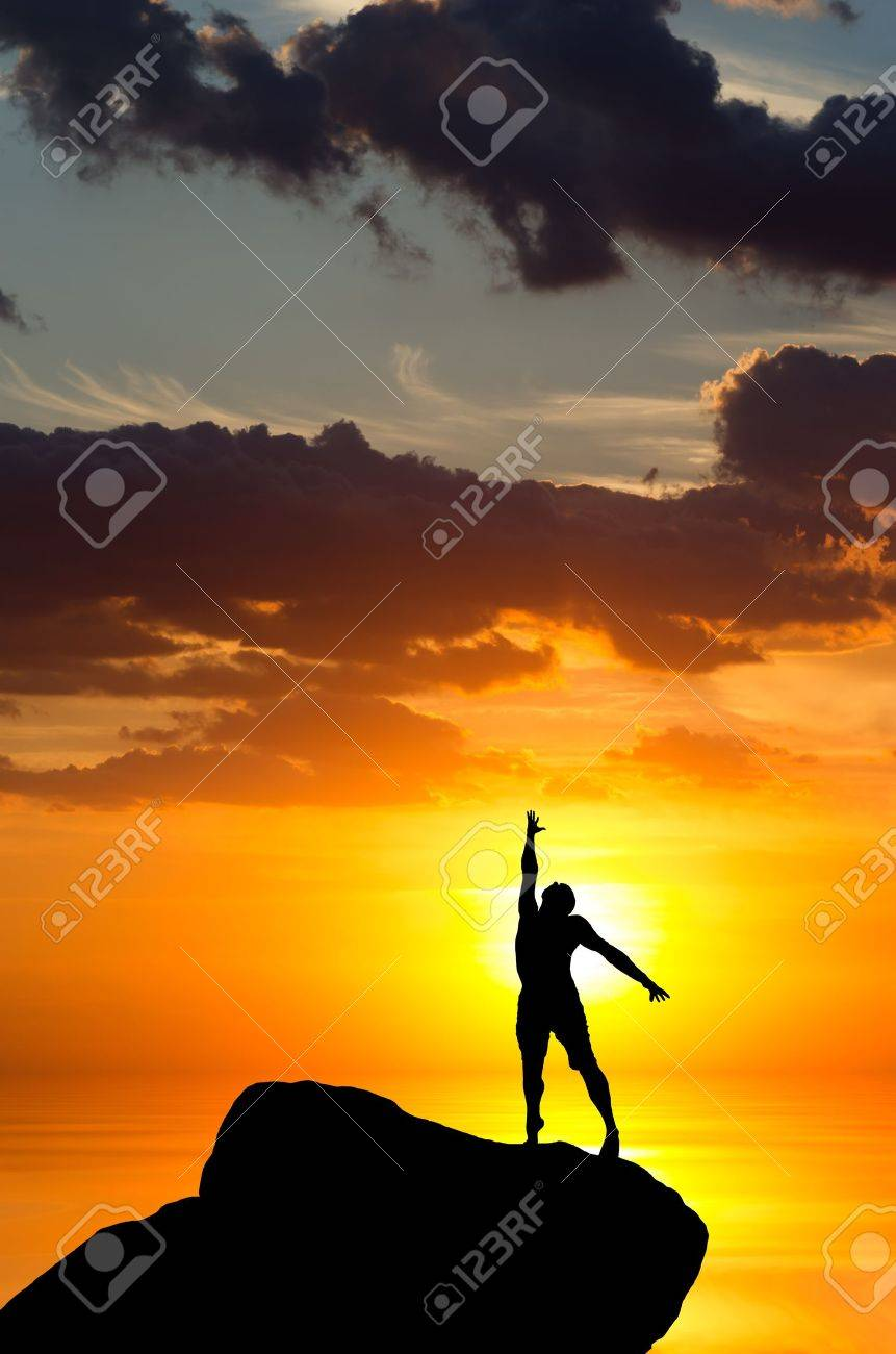man on top of the mountain reaches for the sun Stock Photo - 14488294