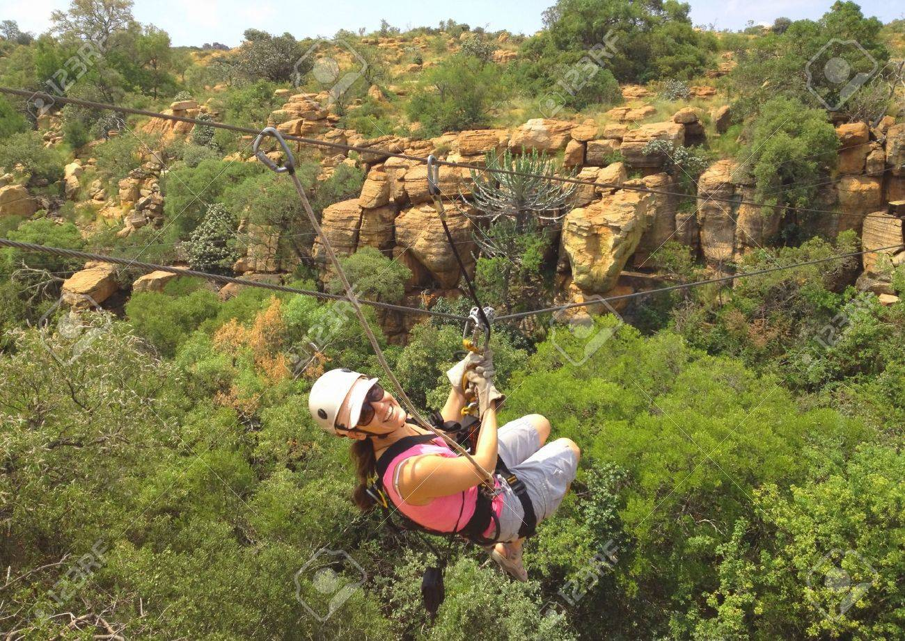 Lady sliding on a zip line across a gorge in South Africa Stock Photo - 12470818