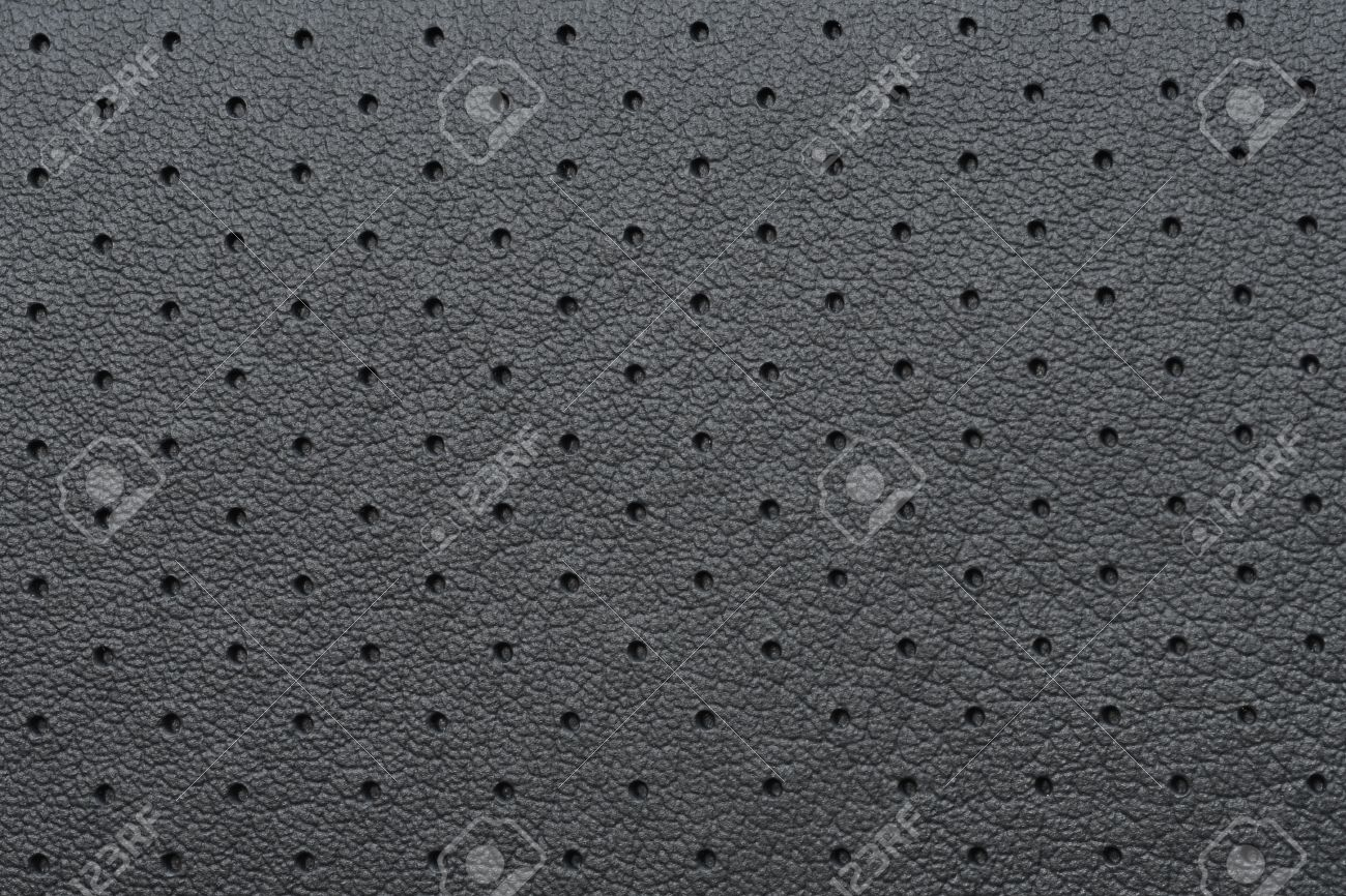 Black Perforated Leather or Skin Texture as Wallpaper or Background Stock Photo - 14783956