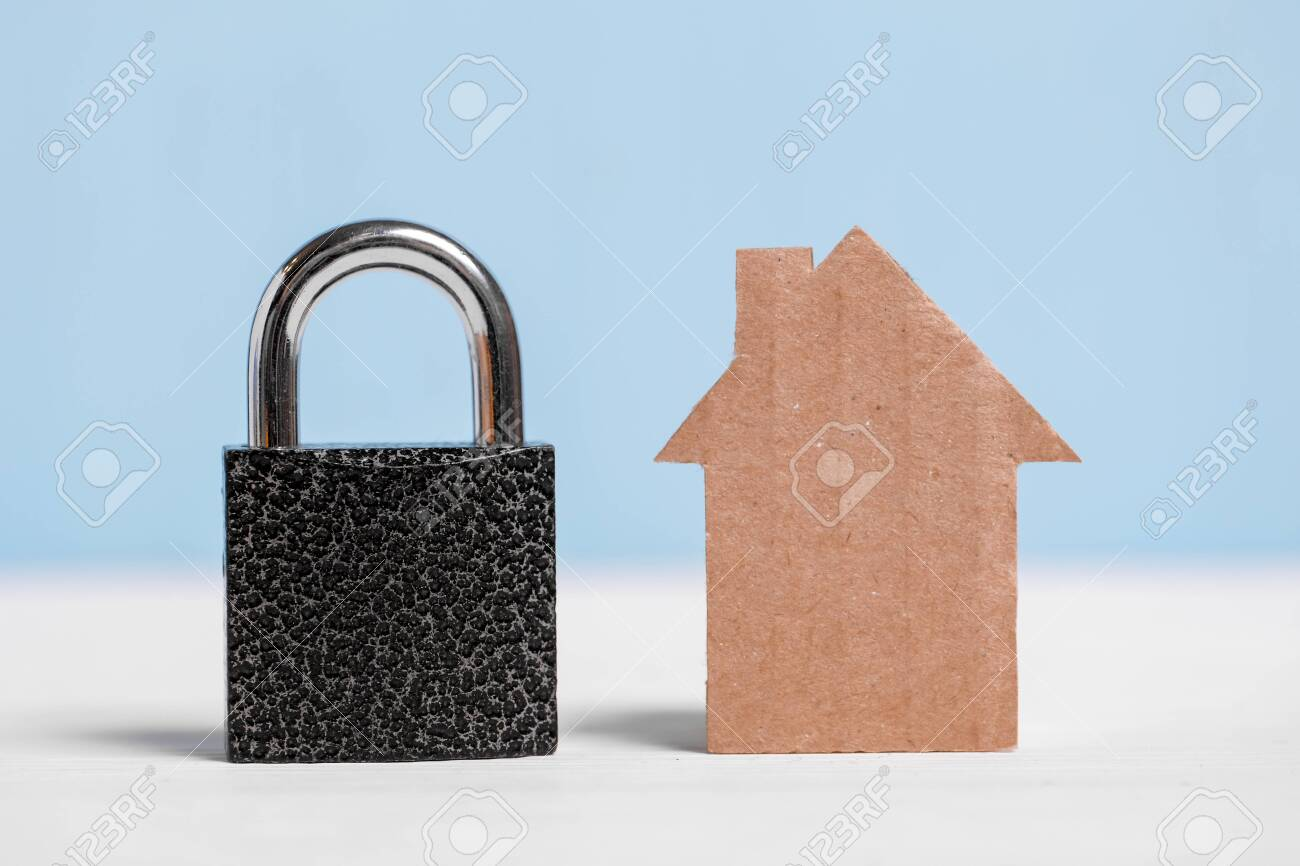 Cardboard Cutout House And Black Padlock On Blue And White Background Stock Photo Picture And Royalty Free Image Image 135094129
