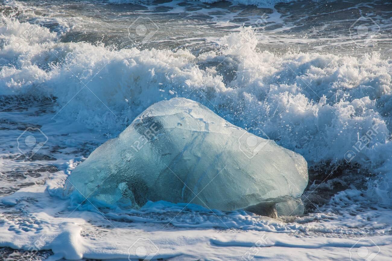 Icebergs on the coast of Diamond beach near Jokulsarlon in South Iceland - 131321431