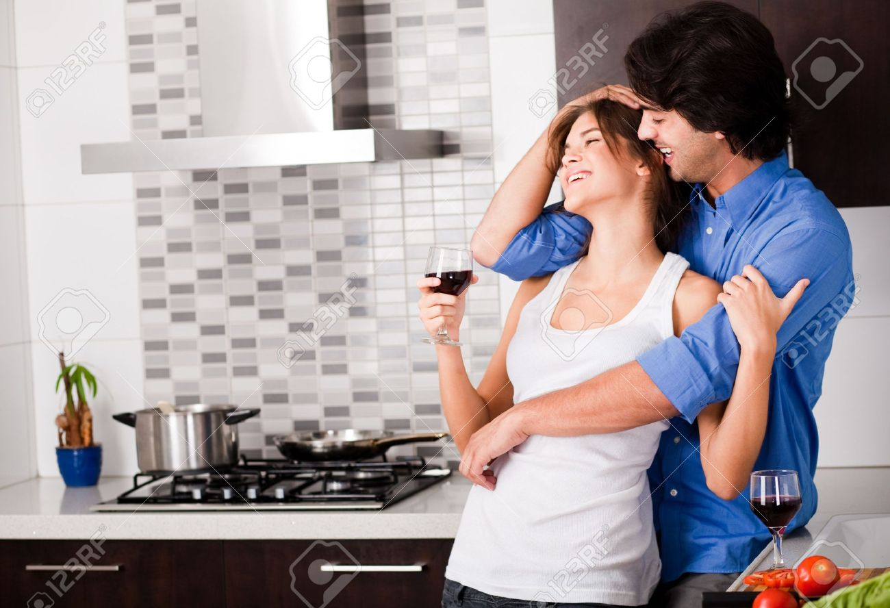 Stock Photo   young couple hug in their kitchen. Young Couple Hug In Their Kitchen Stock Photo  Picture And Royalty