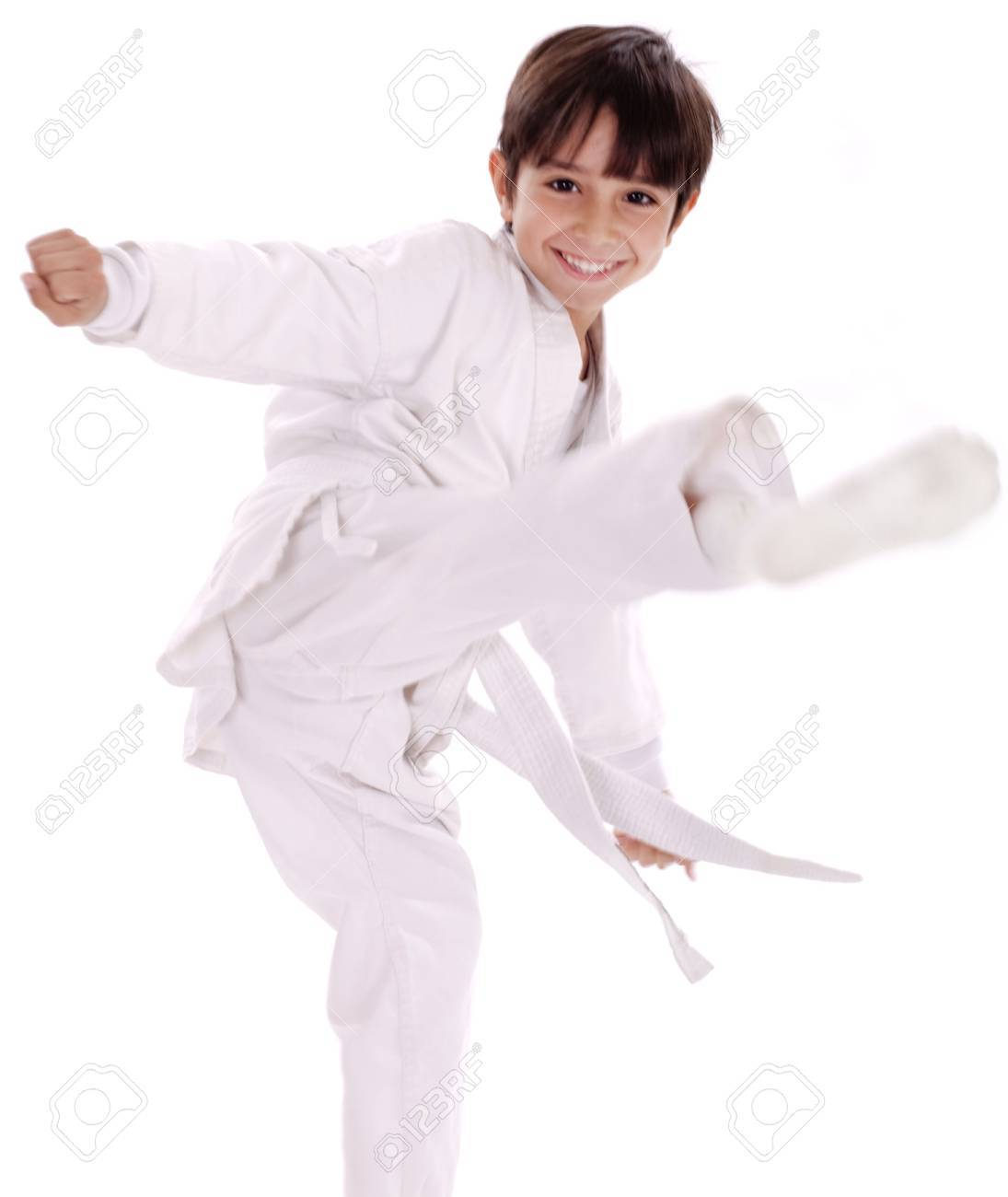 Karate boy excercising isolated white background - 9795713