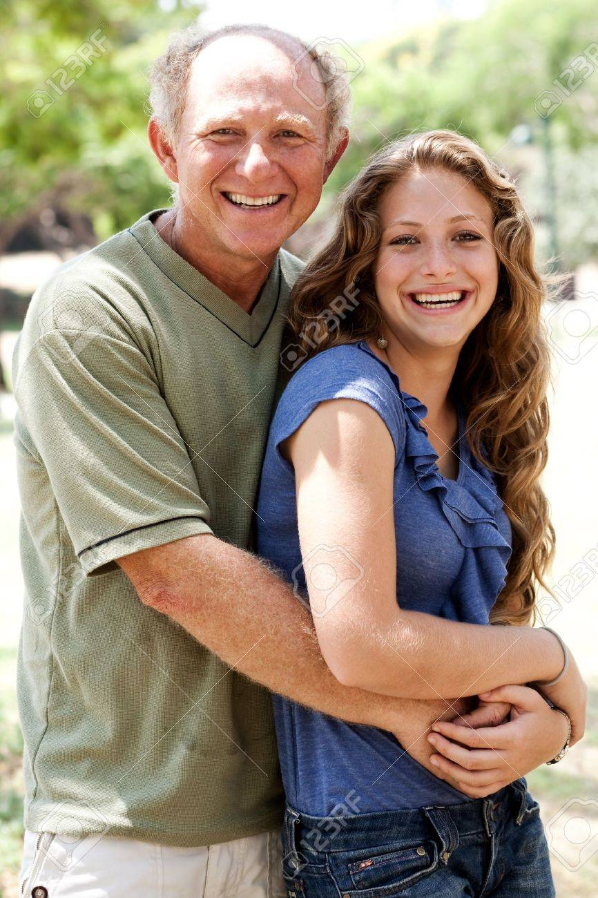 Aged father embracing her daughter and looking at camera Stock Photo - 7526757