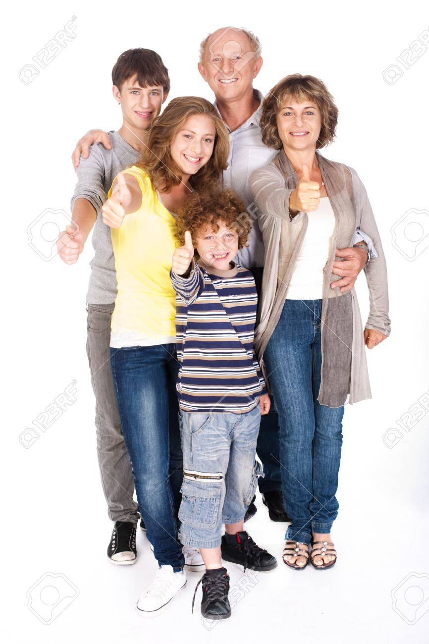 Thumbs-up family posing in style, indoors agianst white background. - 9796190