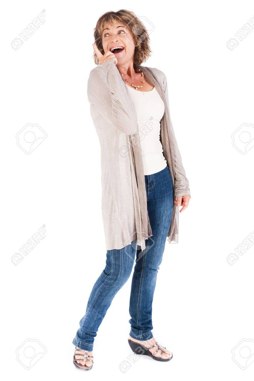 Senior woman pointing upwards and looking away over white background. - 9796168