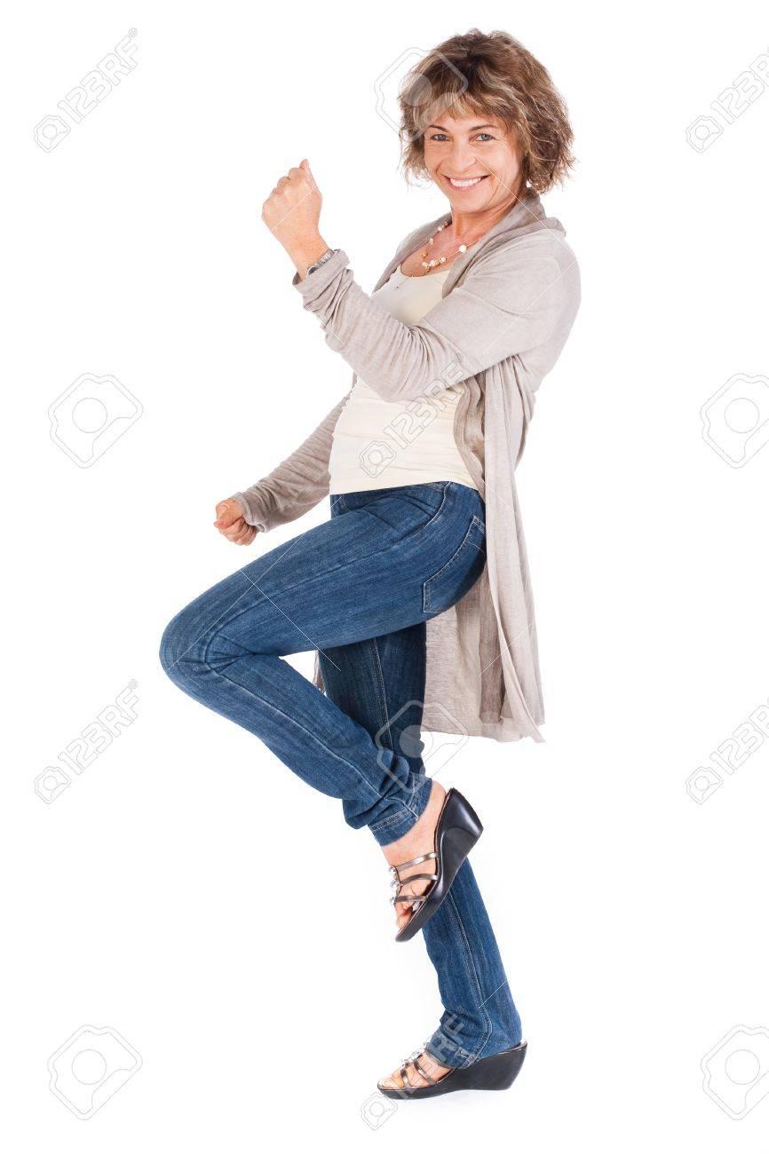 Full length portrait of senior woman isolated over white background. . - 9796436