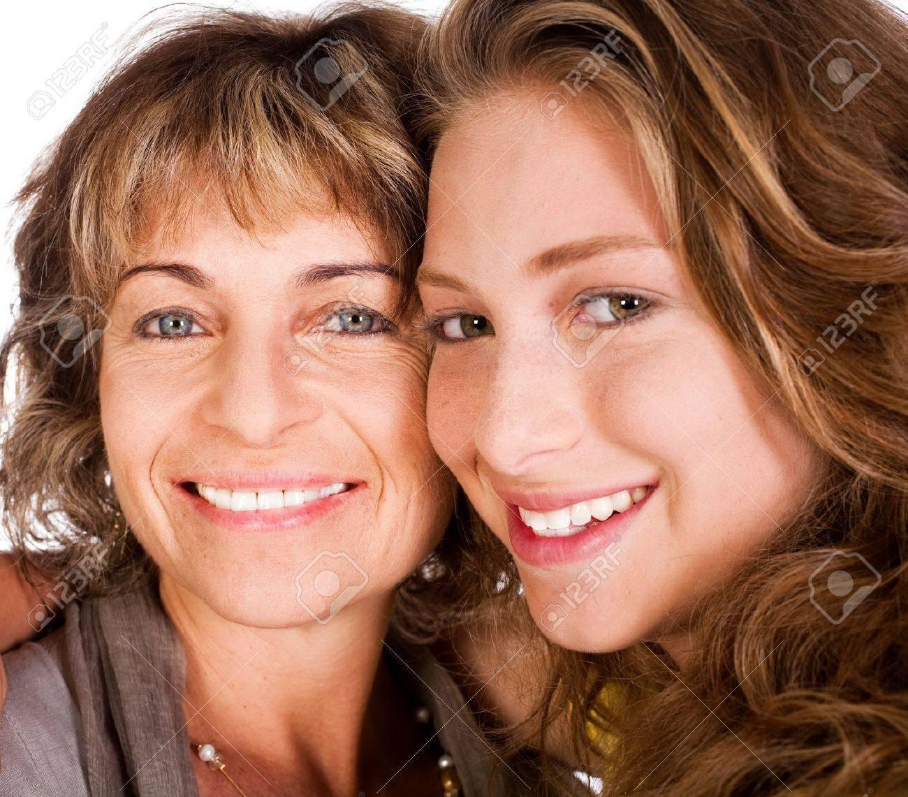 Close-up of smiling elder mum and daughter facing camera... - 9796483