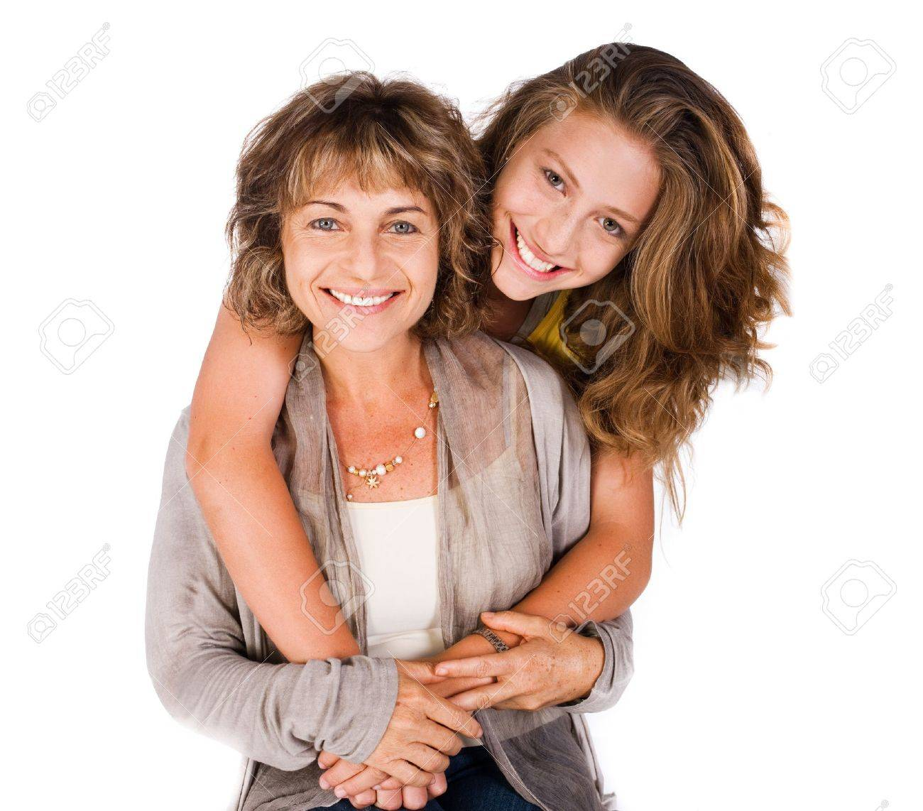 Young pretty daughter hugging her mum from back, indoors. - 9796490