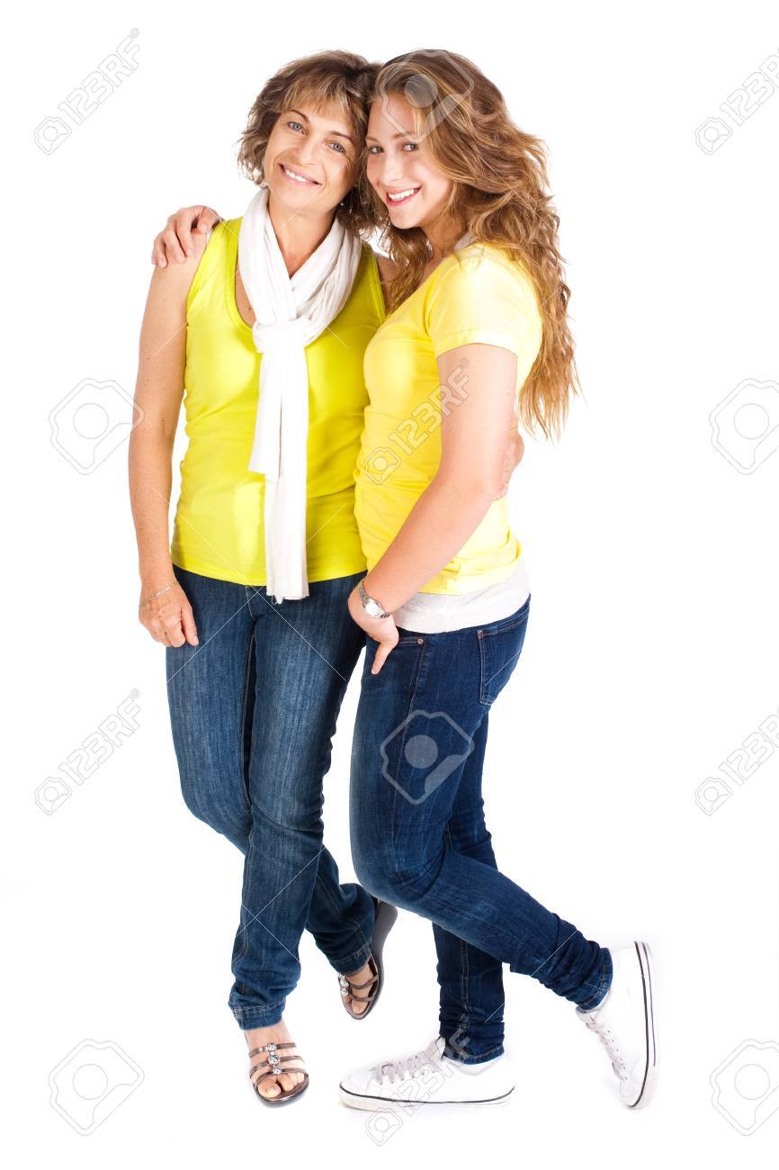 Young pretty daughter embracing her mum, indoors isolated on white background. - 10245215