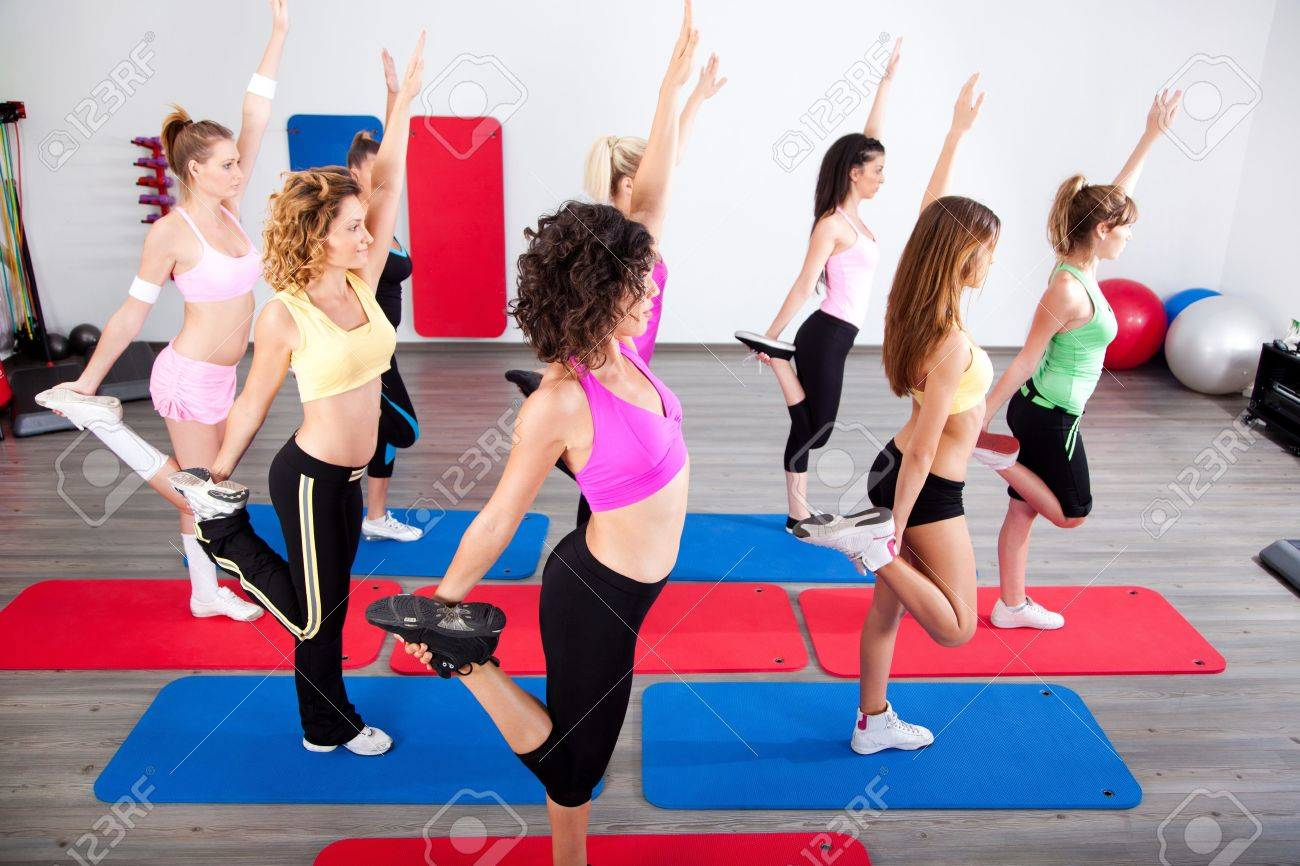 Group of gym people in a stretching class. - 10473997